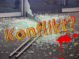 """Foto einer zersprungenen Glastür und davor der Text """"Konflikt?"""""""